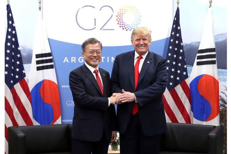 In this Nov. 30, 2018, photo, South Korean President Moon Jae-in, left, shakes hands with U.S. President Donald Trump during a meeting on the sidelines of the Group of 20 Leaders' Summit in Buenos Aires, Argentina.  HWANG KWANG-MO/YONHAP