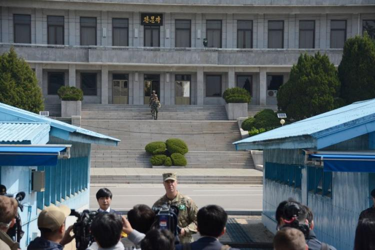 North Korean soldiers march down the steps on their side of the Joint Security Area as Army Lt. Col. Sean Morrow, commander of the United Nations Command Security Battalion, speak to reporters on the south side of the Panmunjom truce village, Wednesday, May 1, 2019. KIM GAMEL/STARS AND STRIPES