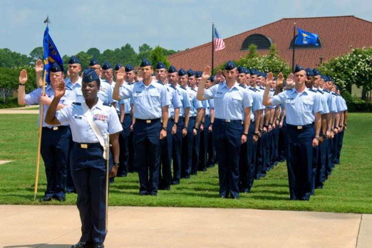 Officer Training School cadets take the oath of office during their graduation parade at Maxwell Air Force Base, Ala., June 2016. The Air Force will test a program that accelerates OTS training for senior noncommissioned officers, cutting the course to 14 days. MELANIE RODGERS COX/U.S. AIR FORCE
