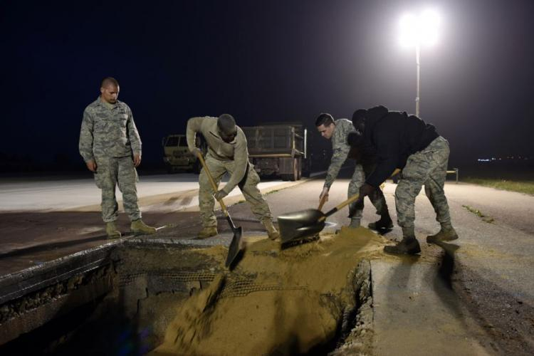 Airmen from the 8th Civil Engineer Squadron work to repair a sinkhole in the runway at Kunsan Air Base, South Korea, May 1, 2019. JOSHUA EDWARDS/U.S. AIR FORCE
