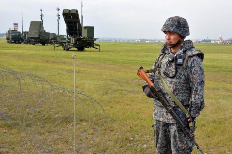 A member of the Japan Air Self-Defense Force guards a Patriot missile-defense system at Yokota Air Base, Japan, Tuesday, Aug. 29, 2017. SETH ROBSON/STARS AND STRIPES