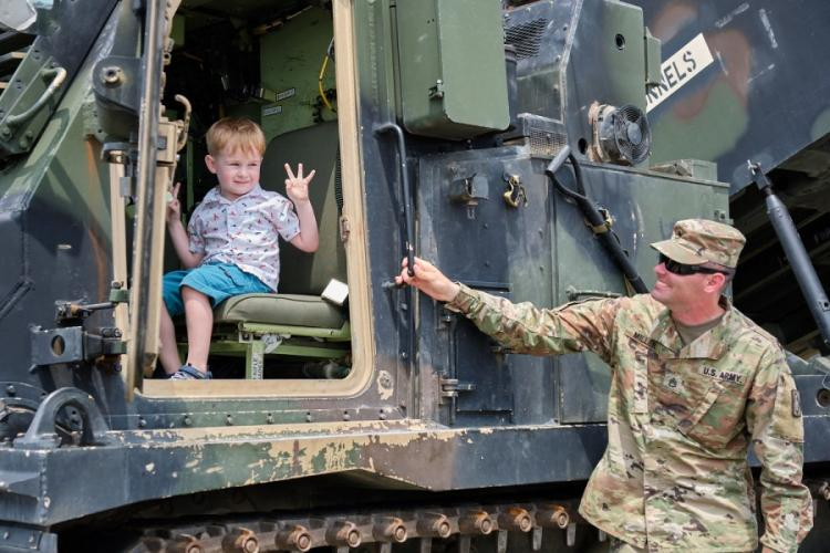 A child poses in the front seat of an M270A1 Multiple Launch Rocket System during the Eighth Army's 75th anniversary celebration at Camp Humphreys, South Korea, Saturday, June 8, 2019. MATTHEW KEELER/STARS AND STRIPES