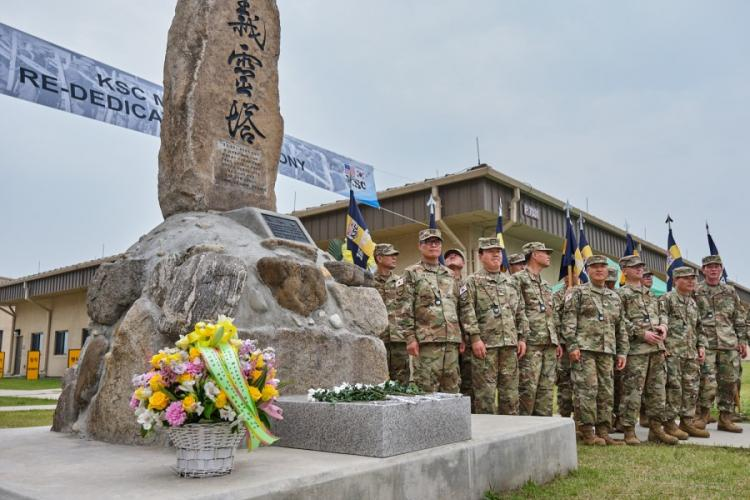 Korean Service Corps paramilitary members pose beside a tribute to fallen KSC members during a rededication ceremony for the monument at Camp Humphreys, South Korea, June 9, 2019. MATTHEW KEELER/STARS AND STRIPES