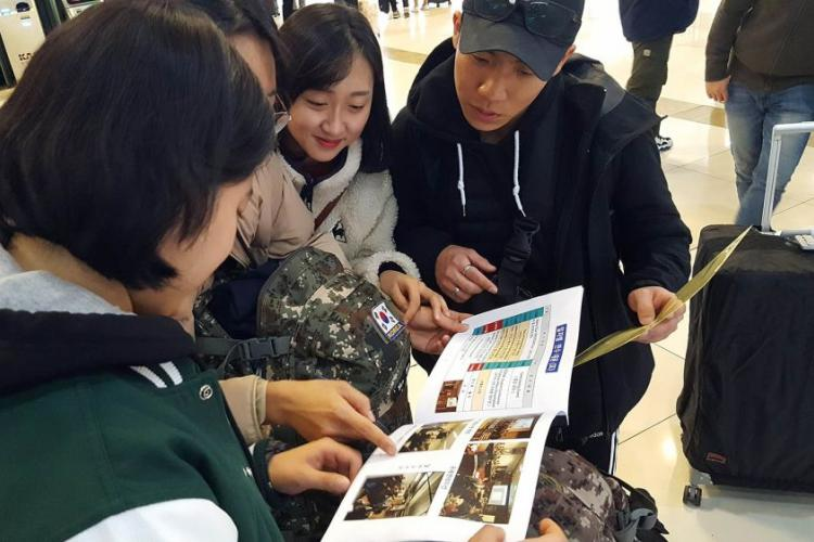 South Korean ROTC cadets look at a pamphlet about their itinerary before leaving Seoul to participate in a monthlong leadership development course at Texas A&M University.  COURTESY OF THE SOUTH KOREAN MILITARY