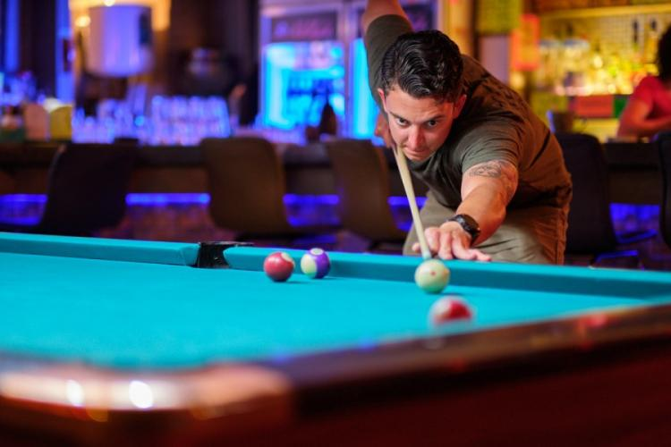 Air Force Staff Sgt. Cody Meyer of the 33rd Rescue Squadron plays pool at a bar just outside Osan Air Base, South Korea, Monday, June 17, 2019. MATTHEW KEELER/STARS AND STRIPES