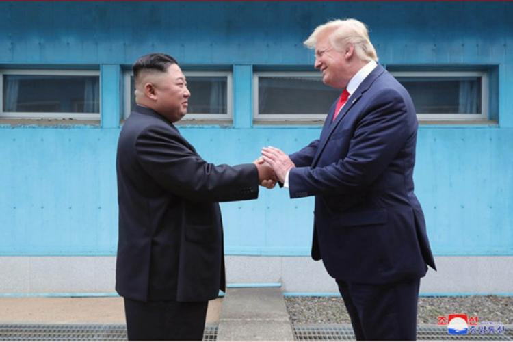 North Korean leader Kim Jong Un and U.S. President Donald Trump shake hands across the line separating North and South Korea on Sunday, June 30, 2019. VIA KCNA