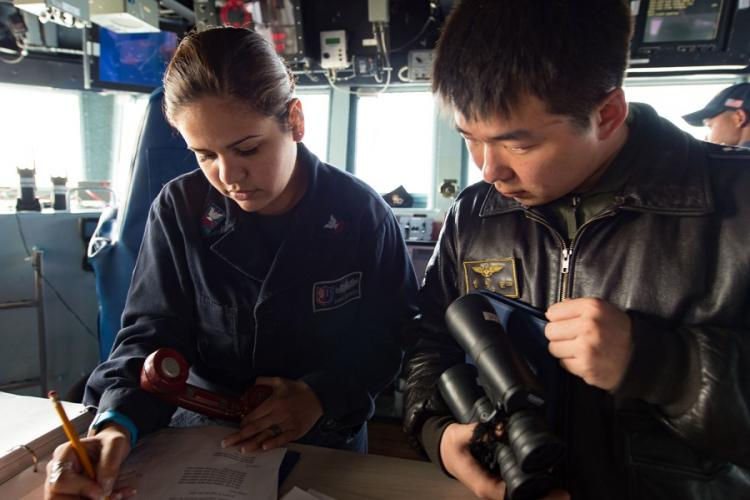 Petty Officer 2nd Class Diana Espinoza communicates ship movements with a South Korean navy sailor during Foal Eagle 2017. JEREMY GRAHAM/U.S. NAVY
