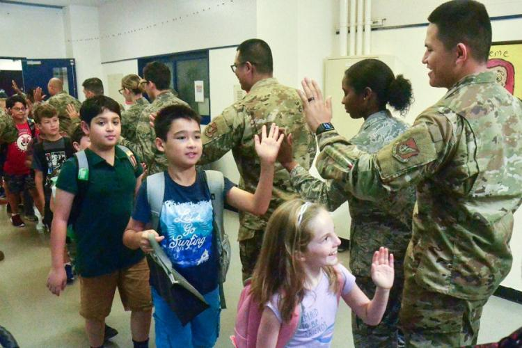 Airmen from the 374th Medical Group greet children at Joan K. Mendel Elementary School on Yokota Air Base, Japan, Monday, Aug. 26, 2019. SETH ROBSON/STARS AND STRIPES