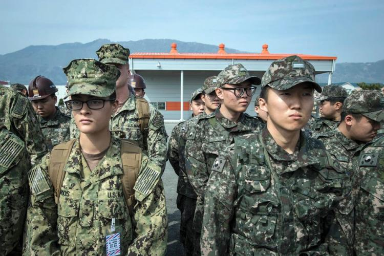 U.S. and South Korean sailors listen to a safety briefing during a Foal Eagle exercise in Jinhae, South Korea, March 13, 2017.  TORREY LEE/U.S. NAVY