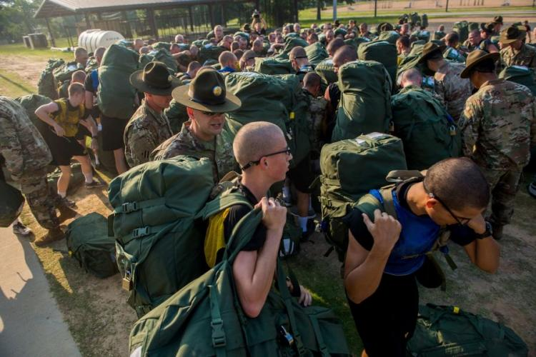 Initial entry trainees arrive at Echo Company, 2nd Battalion, 19th Infantry Regiment, on Fort Benning, Ga., on July 13, 2018, for the first day of the 22-week pilot program for One Station Unit Training for infantry soldiers.  PATRICK A. ALBRIGHT/U.S. ARMY