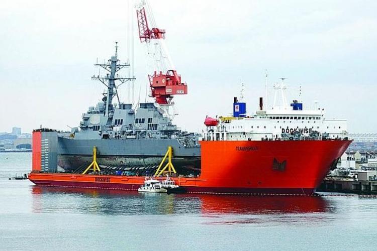 The USS Fitzgerald is seen at Yokosuka Naval Base, Japan, aboard the MV Transshelf, Monday, Nov. 27, 2017. STARS AND STRIPES