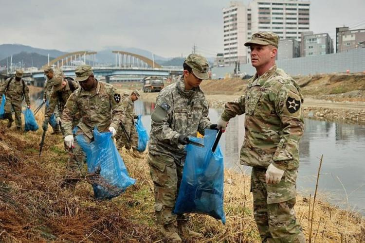 U.S. soldiers from Camp Casey clean up debris along the Shincheon River in Dongducheon, South Korea, Thursday, March 21, 2019. MATT KEELER/STARS AND STRIPES