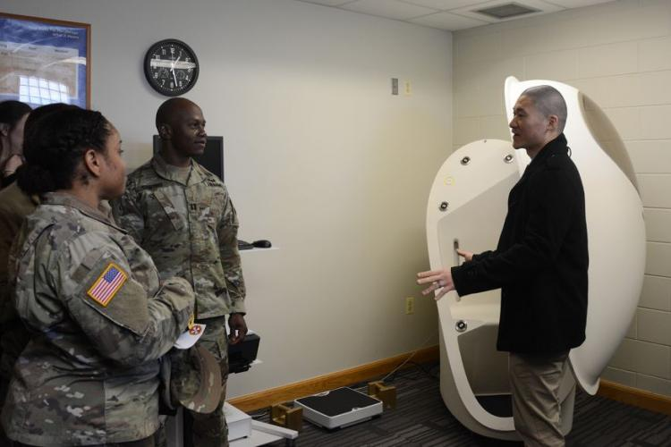 Soldiers listen as John Sim, right, director of the new Army Wellness Center at Camp Humphreys, South Korea, explains how to use the BOD POD, which measures body fat and muscle composition, Friday, March 22, 2019. KIM GAMEL/STARS AND STRIPES