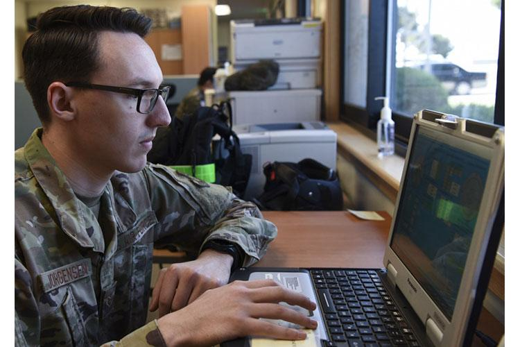 U.S. Air Force Senior Airman Houston Jorgensen, 8th Operations Support Squadron weather forecaster, ensures the TMQ-53 is providing weather data to the laptop at Kunsan Air Base, Republic of Korea, May 8, 2020. The TMQ-53 is a portable, automated weather station used to set up in austere locations to attain weather data from the area. The equipment takes roughly 30 minutes for a two-member team to set up and 45 minutes for a lone member. (U.S. Air Force photo by Staff Sgt. Anthony Hetlage)