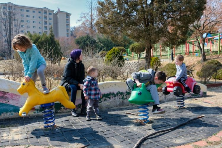 Cindy Badger, a military spouse, watches her four children at a playground on Osan Air Base, South Korea, Monday, March 2, 2020.  MATTHEW KEELER/STARS AND STRIPES