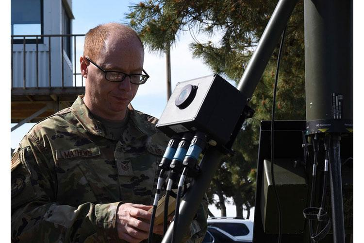 U.S. Air Force Tech. Sgt. Phillip Mathews, 8th Operations Support Squadron weather operations NCO in charge, ensures the TMQ-53 is providing weather data at Kunsan Air Base, Republic of Korea, May 8, 2020. The TMQ-53 is a portable, automated weather station used to set up in austere locations to attain weather data from the area. The equipment takes roughly 30 minutes for a two-member team to set up and 45 minutes for a lone member. (U.S. Air Force photo by Staff Sgt. Anthony Hetlage)