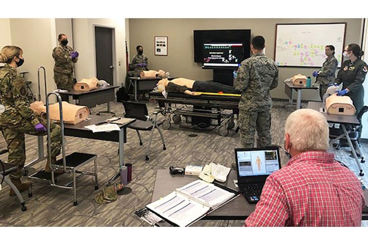 Life support instructors at Seymour Johnson Air Force Base (pictured) reduced class size to allow each trainee the recommended six feet of space in the classroom. Students rotated life saving techniques at their own stations, with a one-to-one ratio of equipment to trainee. (Air Force photo provided by Air Force Maj Sonnie Stevens, Seymour Johnson AFB.)