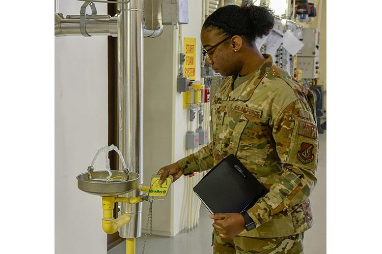 U.S. Air Force Tech. Sgt. Jalleshia Miller, 8th Fighter Wing safety office occupational safety manager, performs a function test on an eyewash station during an inspection at Kunsan Air Base, Republic of Korea, April 22, 2020. As a member of the occupational safety team, Miller works to prevent injuries on and off the job. (U.S. Air Force photo by Tech. Sgt. Joshua Arends)