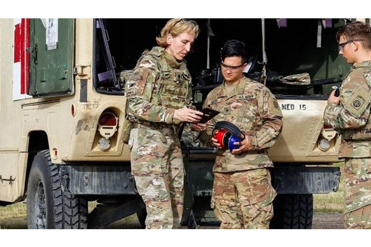 Lieutenant Colonel Jillyen Curry-Mathis, senior audiologist for the XVIII Airborne Corps, Fort Bragg, North Carolina, conducts hearing tests in an Army field litter ambulance while in an austere environment. (Photo by XVIII ABN Corps Public Affairs)