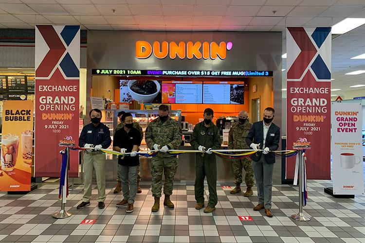 (From left to right) Pak, Kye-hwan, service business manager, Yang, Kyung-sok, Dunkin' contractor, Col. Robert L. Bartlow Jr., 8th Mission Support Group commander, Col. Michael P. Richard, 8th Fighter Wing vice commander and Jordan J. Flint, general manager, prepare to cut the ceremonial ribbon for the grand opening of Dunkin' Donuts at Kunsan Air Base, July 9. Leadership from both the Exchange and 8th Fighter Wing work to support each other for the betterment of the Kunsan community.