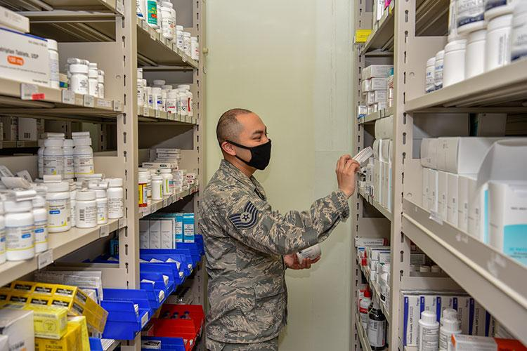 U.S. Air Force Tech. Sgt. Tyrone Rocha, 8th Medical Support Squadron NCO in charge of pharmaceutical services, checks inventory at Kunsan Air Base, Republic of Korea, May 6, 2020. The pharmacy team provides medical support to over 2,500 members of the Wolf Pack to keep them fit to fight. (U.S. Air Force photo by Tech. Sgt. Joshua Arends)