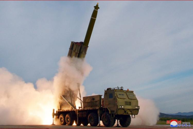 """North Korea shows the launch of what it called a """"super-large multiple rocket launcher system"""" that was observed by leader Kim Jong Un. KCNA"""