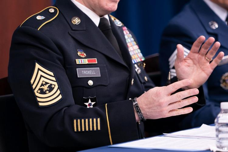 Army Command Sgt. Maj. John Wayne Troxell, senior enlisted adviser to the chairman of the Joint Chiefs of Staff, speaks as he prepares to depart the position during a news briefing in the Pentagon Press Briefing Room on Dec. 9, 2019, in Washington. Troxell wore the new rank insignia for his position while meeting with reporters Monday ahead of his retirement Friday. JAMES K. MCCANN/DOD