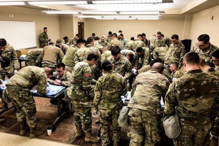 Combat medic specialists with Headquarters and Headquarters Company, 3rd Armored Brigade Combat Team, 1st Armored Division (Rotational), gather at U.S. Army Garrison Camp Humphreys for advanced medical training, Feb. 14. Suturing is a perishable skill that takes practice. An inexperienced combat medic specialist may leave a lasting scar. (Courtesy U.S. Army photo by Sgt. 1st Class Yu Rhee, 3rd ABCT, 1st AD, Medical Operations NCO) (Photo Credit: Sgt. Alon Humphrey)