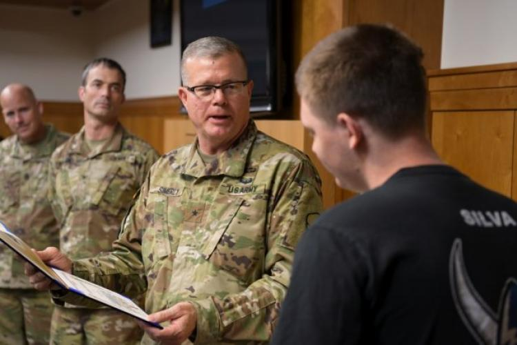 Army Brig. Gen. Mark Simerly, commander of the 19th Expeditionary Sustainment Command, prepares to gift Jacob Silva with a certificate of appreciation at the Camp Carroll Community Activity Center (CAC), Aug. 11, 2019 at Camp Carroll, South Korea. In coordination with the U.S. Army, the Make-A-Wish Foundation organized a party for Silva at the CAC. (Photo Credit: Sgt. Austin Fox)