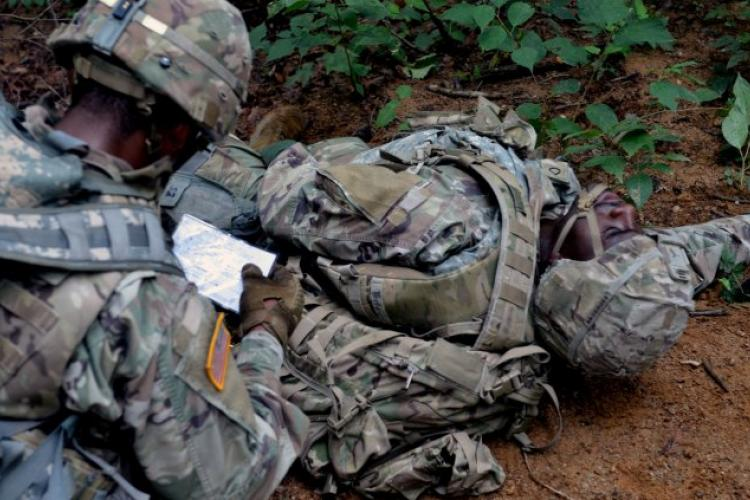 CAMP HOVEY, Republic of Korea - A Soldier with 6th Squadron, 9th Cavalry Regiment, 3rd Brigade Combat Team, 1st Cavalry Division reads the casualty card for an injured Soldier in order to determine the injuries he will have to treat as part of the Saber First Responder Course testing, August 16. The weeklong course teaches Soldiers how to provide extended care to the wounded in austere environments. (Photo by KCpl. Song, Junghwan, 3/1CAV Public Affairs)