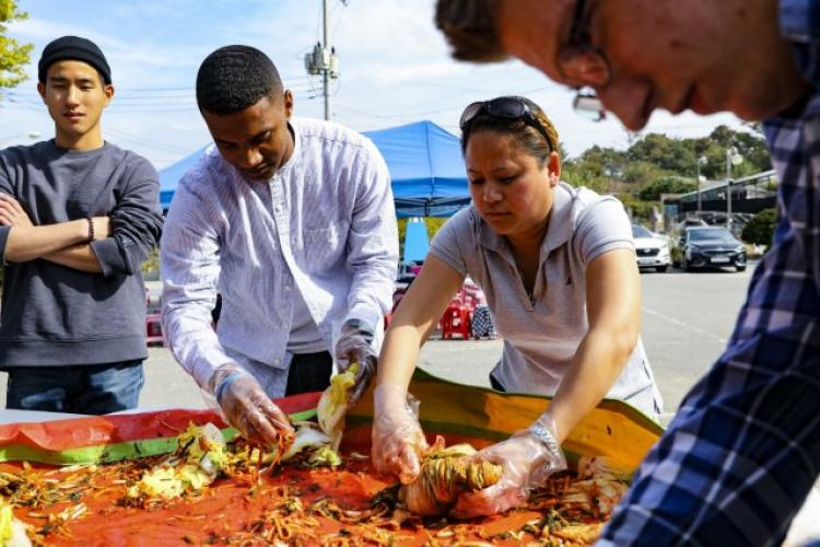 U.S. Soldiers, Marines, and Airmen learned how to make Kimchi near Asan, Republic of Korea, Oct. 23, 2019. U.S. Soldiers, Marines, and Airmen enjoy a three-day cultural tour sponsored by the Korean Ministry of National Defense to help service members understand the Korean culture, appreciate their service in the Republic of Korea, and to help build the ROK/US alliance. (Photo by Staff Sgt. Jacob Kohrs)