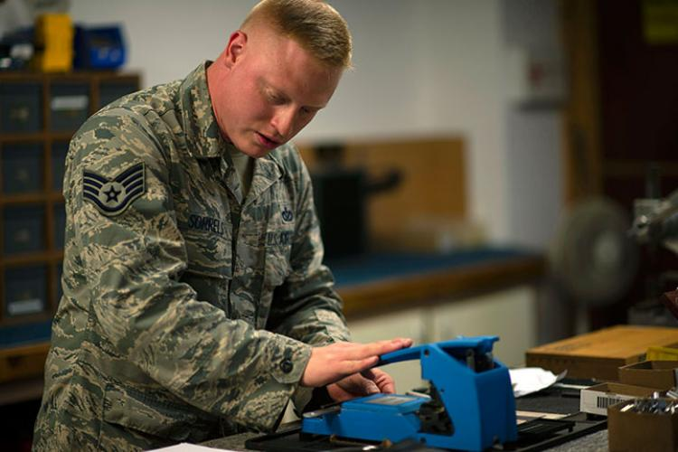 U.S. Air Force Staff Sgt. Josiah Sorrels, 8th Civil Engineer Squadron lock shop noncommissioned officer in charge, cuts a copy of a key using a punch at Kunsan Air Base, Republic of Korea, June 22, 2018. Maintaining locks and creating new keys are part of the day to day operations the structures shop is responsible for. (U.S. Air Force photo by Tech. Sgt. Charles McNamara)