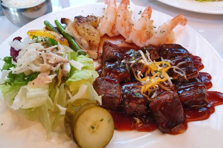 The shrimp-and-steak combo from Bulldog Steak in Pyeongtaek, South Korea, features a house sauce that is sure to be a hit with many diners. MATTHEW KEELER/STARS AND STRIPES