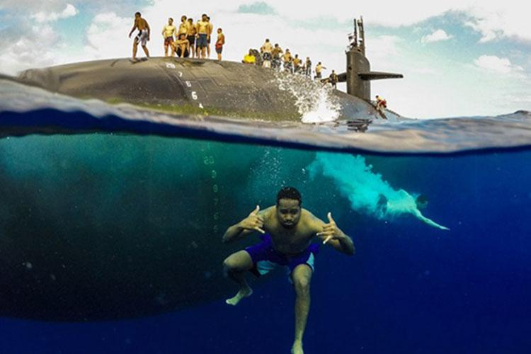 Sailors assigned to the Los Angeles-class fast-attack submarine USS Olympia (SSN 717) participate in a swim call in the Pacific Ocean, July 31, 2018 (Photo by: Navy Fire Control Technician Senior Chief Vien Nguyen).