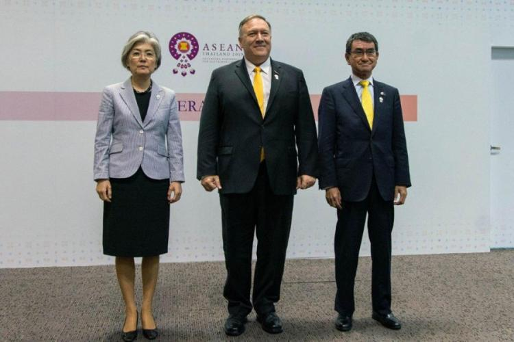 Secretary of State Mike Pompeo, center, poses with his South Korean counterpart, Kang Kyung-wha, left, and his Japanese counterpart, Taro Kono, after their trilateral meeting in Bangkok, Thailand, Aug. 2, 2019. RON PRZYSUCHA/STATE DEPARTMENT