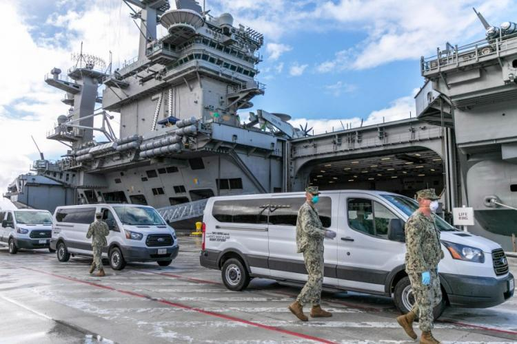 USS Theodore Roosevelt sailors who tested negative for COVID-19 are moved to lodging and quarantine on Guam, April 3, 2020. A sailor assigned to the Roosevelt is in intensive care following complications from a coronavirus infection, the Navy said. MATTHEW R. WHITE/U.S. NAVY