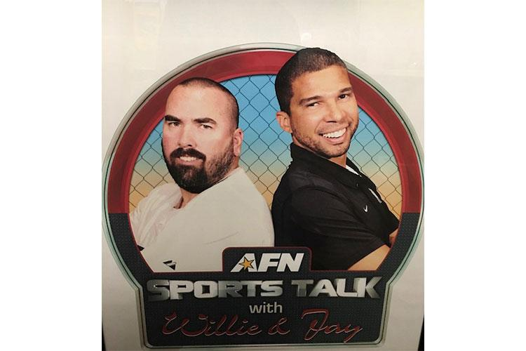 AFN sports programmers  Willie Price (far left) and Jason Stevenson (right) program all the sports you see on AFN television.   They work at the American Forces Network (AFN) Broadcast Center in Riverside, California.