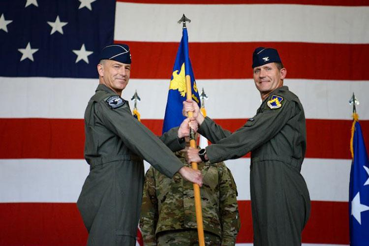Lt. Gen. Scott Pleus, Seventh Air Force commander, presents the ceremonial guidon to Col. John Gallemore during the 8th Fighter Wing change of command at Kunsan Air Base, Republic of Korea, June 1, 2021. Col. John Gallemore, 8th FW incoming commander, assumed command of the 8th FW from the outgoing commander, Col. Christopher Hammond. (U.S. Air Force photo by Staff Sgt. Mya M. Crosby